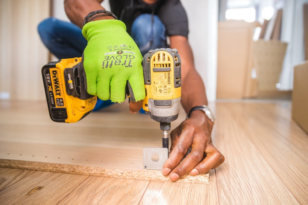 Person using a drill inside a home